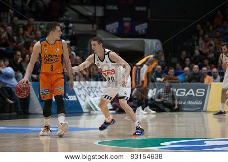 VALENCIA, SPAIN - FEBRUARY 15: Nedovic 8, Carroll during Spanish League match between Valencia Basket Club and Real Madrid at Fonteta Stadium on February 15, 2015 in Valencia, Spain