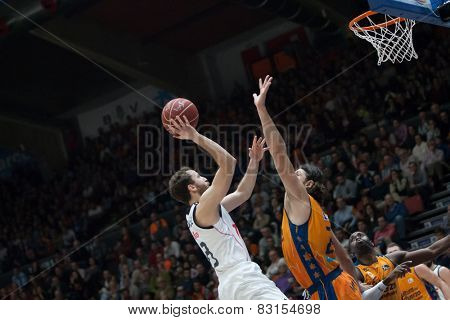 VALENCIA, SPAIN - FEBRUARY 15: Rodriguez with ball and Loncar during Spanish League match between Valencia Basket Club and Real Madrid at Fonteta Stadium on February 15, 2015 in Valencia, Spain