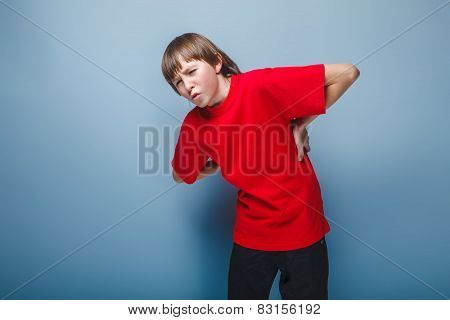 boy teenager European appearance in a red shirt holding his hand
