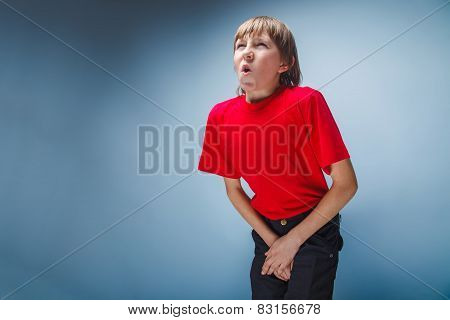 boy teenager European appearance in a red shirt holding hands in