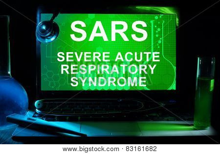 Computer with words SARS (Severe Acute Respiratory Syndrome).