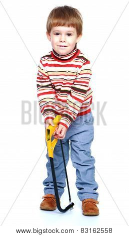 cheerful little boy holding a hacksaw.