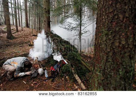 Man Lighting An Emergency Fire