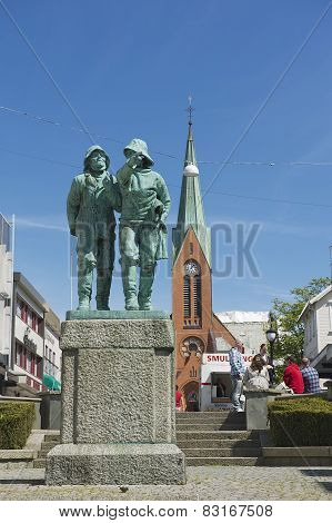 Exterior of the statue of two fishermen at the central square in Haugesund, Norway.