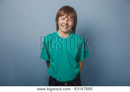 European-looking boy of ten years of laughter, a smile, a joke o
