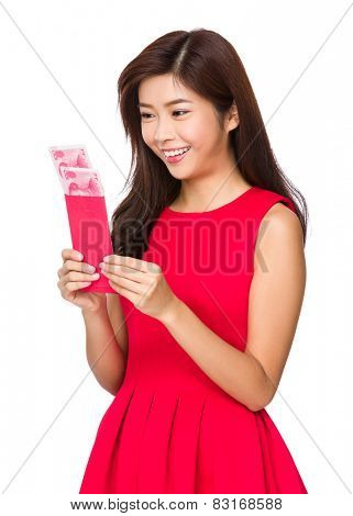 Chinese Woman look at the red pocket money