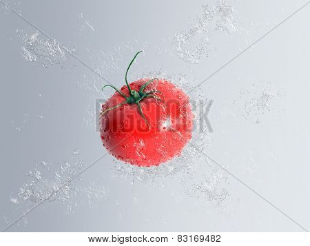 Ripe red fresh tomato falling through water with bubble and splash effect over a graduated grey background in a healthy diet concept