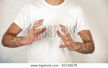 Close up Man in White Shirt Doing Conceptual Palm to Palm with Water Splash Effect on Off White Background.