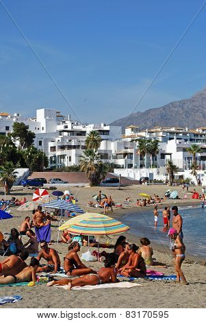 Holidaymakers on beach, Marbella.