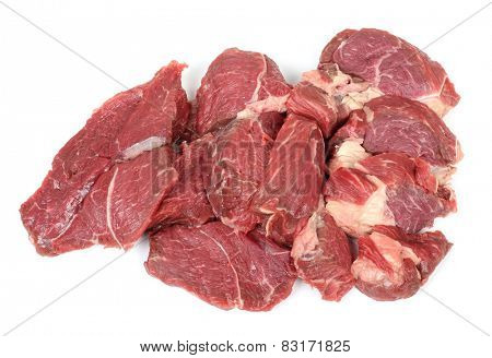 Piece of raw red meat on a white background