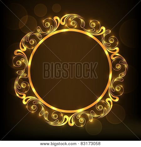 Shiny floral design decorated golden frame in circle shape on brown background.