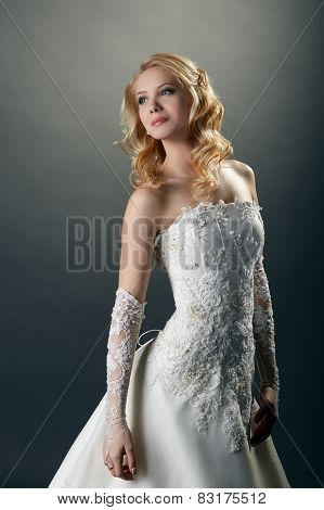 Beautiful bride in elegant dress with embroidery