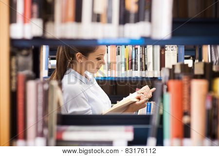 Young Student Searching For Books