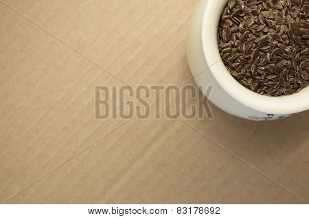 Brown Linseeds In A White Porcelain Cup Close Up