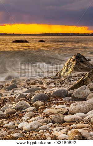 Rocks At Osmington Reflecting Sunset Colours