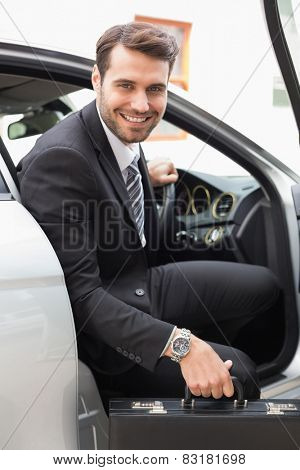 Businessman getting out the front door in his car