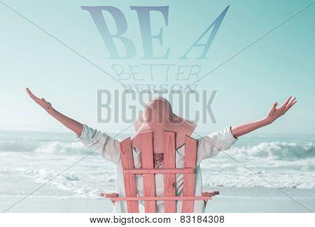 Woman relaxing in deck chair by the sea against be a better person
