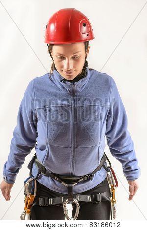 Young woman in climbing equipment