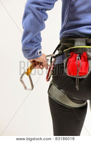 Woman with climbing equipment
