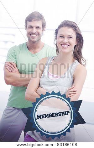 The word membership and portrait of a fit couple with arms crossed in exercise room against badge