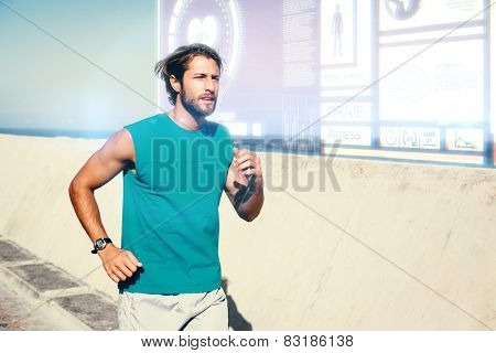 Fit man jogging on promenade against fitness interface