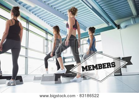 The word members and four women at aerobics against badge