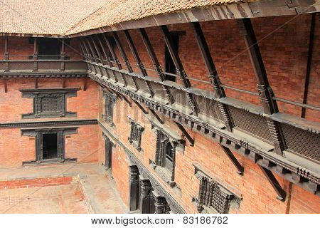PATAN, NEPAL - APRIL 2014 : View of the external corridor on the balcony at Patan Museum in Patan, Nepal on 13 April 2014. Patan Museum is an old royal palaces of the Kathmandu Valley.