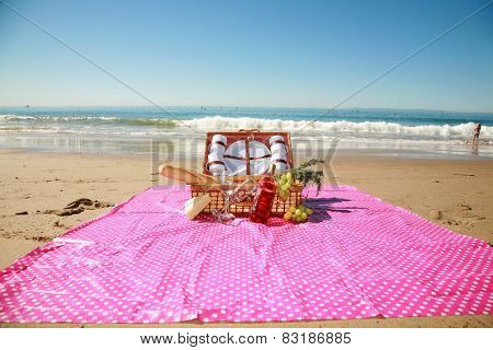 Picnic on the beach. A typical Laguna Beach California picnic with the Pacific Oceans Gentle Tide rolling in slowly as the warm February Sun Rolls across the beautiful blue sky.