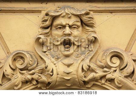 Funny mascaron on the Art Nouveau building in Prague, Czech Republic.