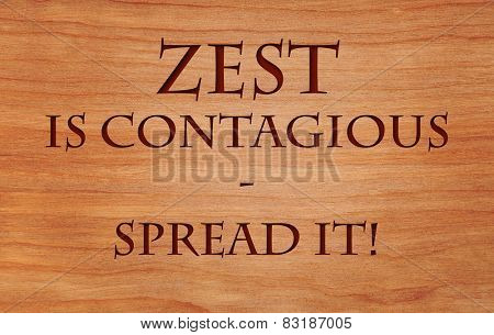 Zest is contagious - spread it - a motivational quote on wooden background