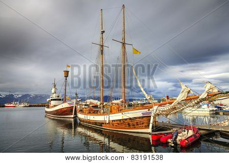 Husavik harbor in Northern Iceland with whale watching boats