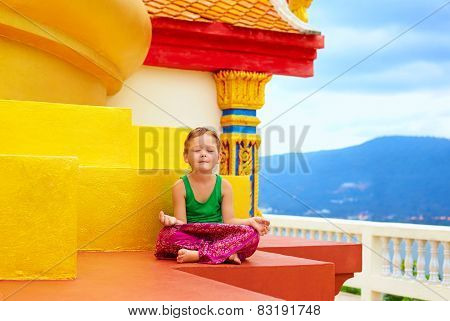 Young Boy Meditating At Buddhist Temple