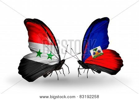Two Butterflies With Flags On Wings As Symbol Of Relations Syria And  Haiti