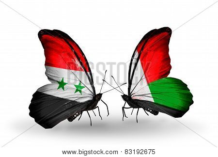 Two Butterflies With Flags On Wings As Symbol Of Relations Syria And Madagascar