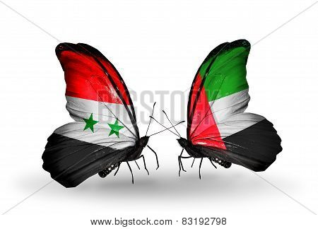 Two Butterflies With Flags On Wings As Symbol Of Relations Syria And United Arab Emirates