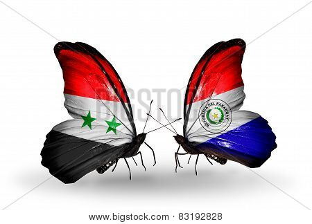 Two Butterflies With Flags On Wings As Symbol Of Relations Syria And Paraguay