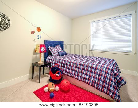 Children's boy's blue and red bedroom playroom. Interior design.