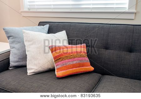 Designer pillows on a sofa