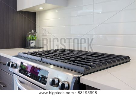 Fragment of a modern kitchen with a gas stove