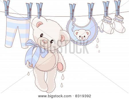 Teddy bear after washing drying on a rope...