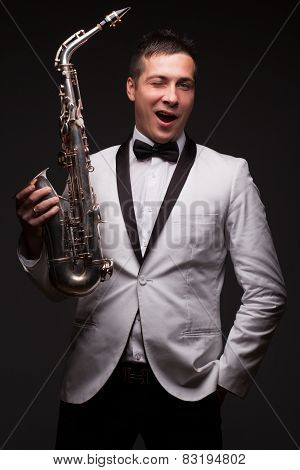 Winking Happy Sax Player. White Jacket And Tie