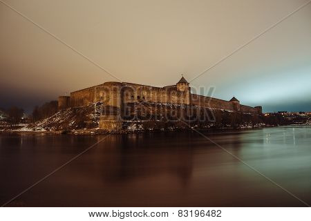 The medieval fortress Ivangorod, night landscape, river Narva