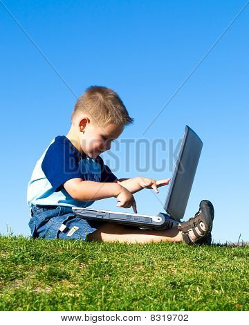 child browsing internet computer