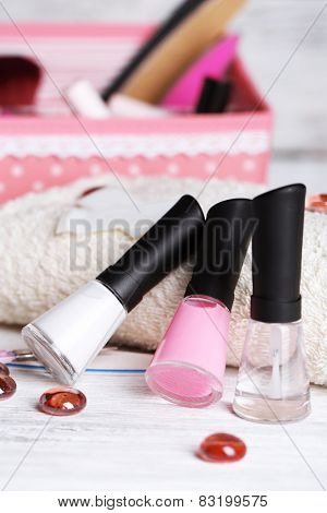 French manicure set with strengthener,white tip polish, dividers and top coat shine applicator for nails on color wooden background