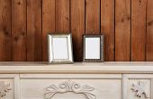 image of chest  - Photo frames on chest of drawers - JPG