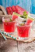 stock photo of watermelon  - Watermelon drink in glasses with slices of watermelon