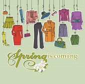 Постер, плакат: Womans clothing and accessories hanging on ropes Spring