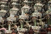 image of guardian  - Demon Guardian statues decorating the Buddhist temple Wat Arun in Bangkok Thailand - JPG