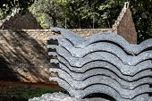 stock photo of urbanisation  - Roof tiles for an incomplete house stacked outside ready for use - JPG