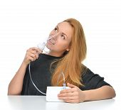 stock photo of inhalant  - Young woman using nebulizer for respiratory inhaler Asthma Treatment isolated on a white background - JPG